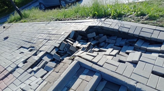 Tiles on St. Michael's waterfront went the waves and fell after a night of rain