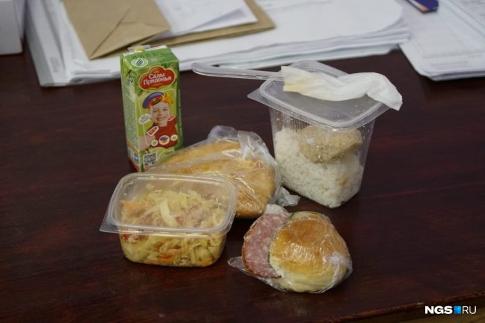 The members of the election Commission showed the food rations they were given on the day