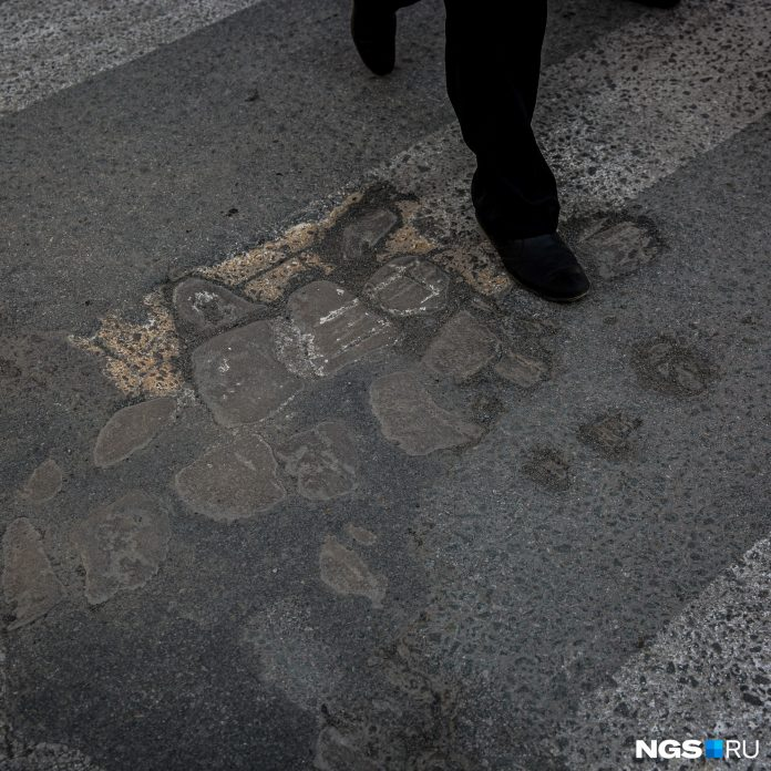 In Novosibirsk from-under asphalt pavement seemed a century