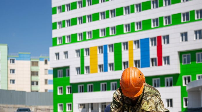 10 frames from the construction site of a new perinatal centre — he has already painted in bright colors