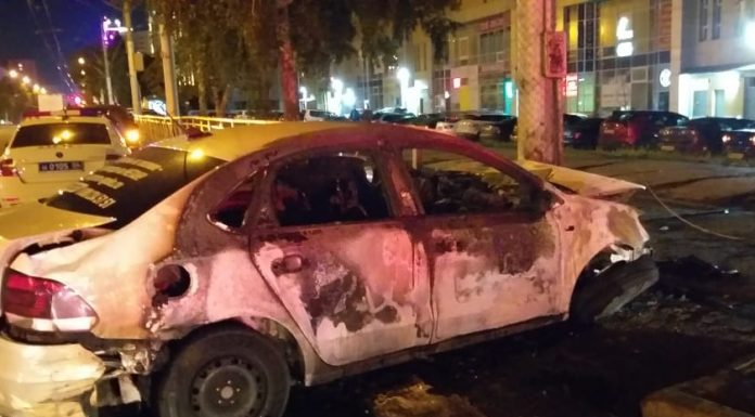 The traffic police said, in what state was the driver of a burning taxi in Novosibirsk